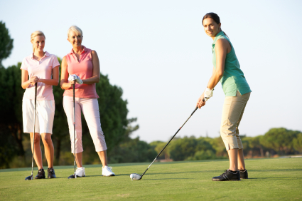 Group Of Female Golfers Teeing Off On Golf Course